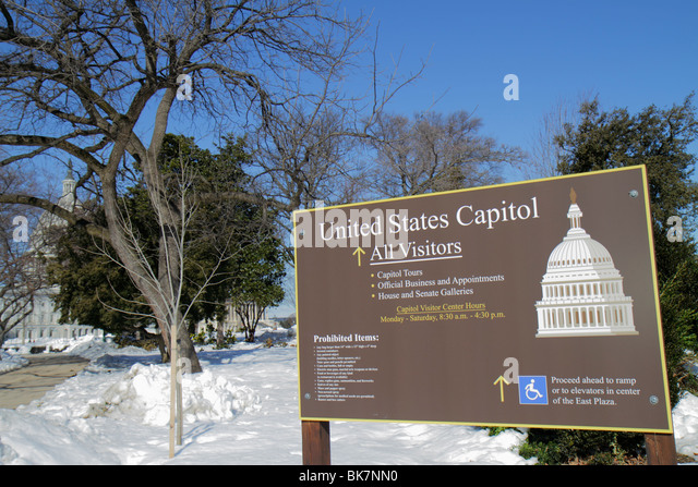 Washington DC United States US Capitol visitor center tours hours prohibited items security sign winter snow dome - Stock Image
