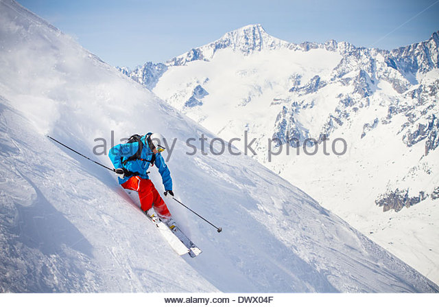 Full length of man skiing on mountain slope - Stock Image