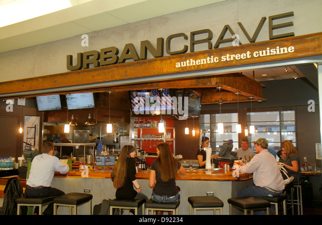 Texas Houston George Bush Intercontinental Airport IAH concourse gate area UrbanCrave Urban Crave restaurant counter - Stock Image