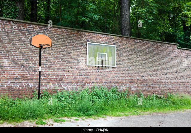 Basketball hoops on wall - Stock Image