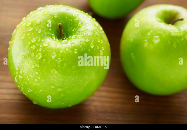 Healthy nutrition concept with apples on the wooden table, selective focus - Stock Image