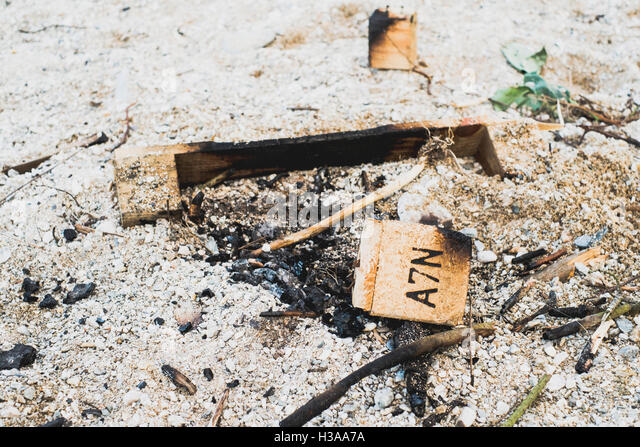 Remains of a pallet used for a bonfire at Gyllyngvase Beach, Falmouth, Cornwall. - Stock Image