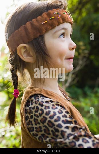Girl dressed as Native American - Stock-Bilder