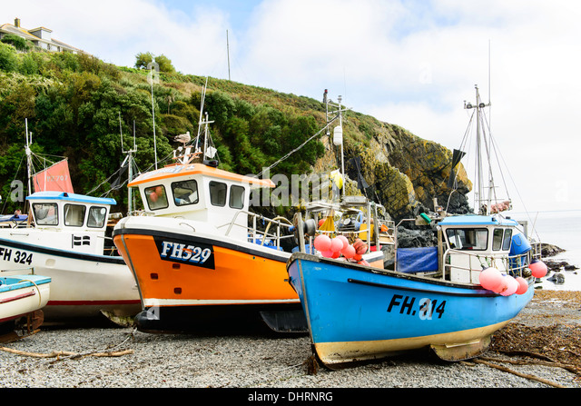 Fishing boats beached at Cadgwith Cornwall UK - Stock Image