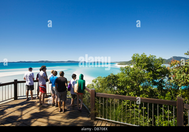 Tourists at the scenic lookout overlooking Hill Inlet and Whitehaven Beach. Whitsunday Island, Queensland, Australia - Stock Image