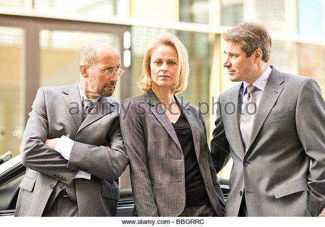 Three mature colleagues posing Munich, Bavaria, Germany - Stock Image