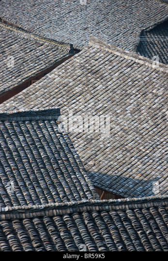 Black tile roof of village house, Longsheng, Guangxi, China - Stock Image