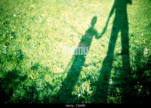 SON AND FATHER HOLDING HANDS - Stock-Bilder