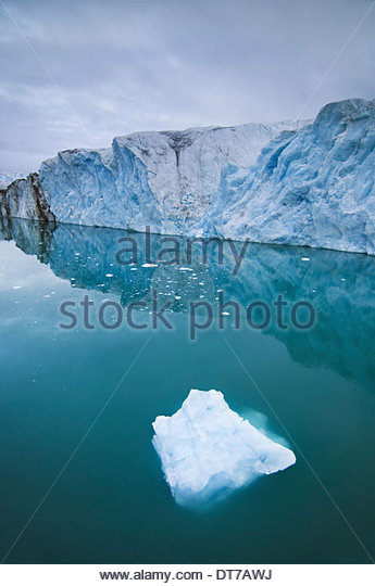 Ice floes and cliffs on the coastline where the Monaco glacier reaches the sea at Spitsbergen Norway Spitsbergen - Stock Image