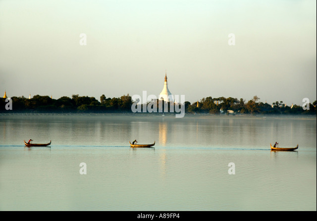 Lake with three rowing boats and white stupa Amarapura Mandalay Burma - Stock Image