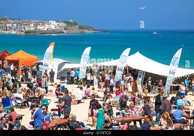 Visitors to the annual food festival on Porthminster beach in st.Ives, Cornwall, UK - Stock Image