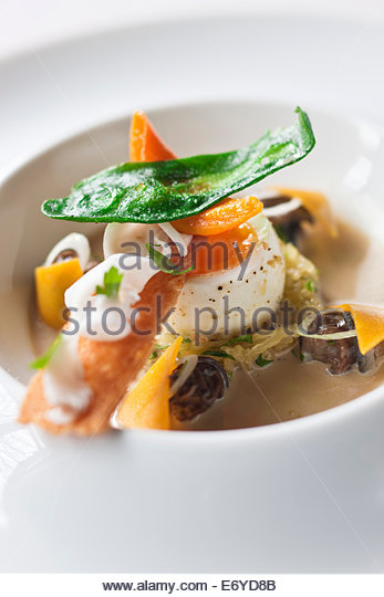 Soft-boiled egg,spaghetti marrow and snails from L'île de Groix - Stock Image