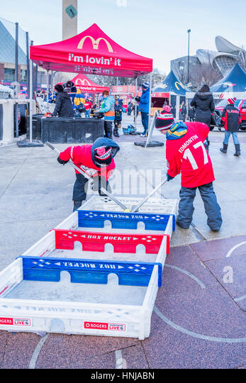 Boys playing Box Hockey, Rogers Hometown Hockey Event, Winston Churchill Square, Edmonton, Alberta, Canada - Stock Image