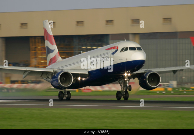 British Airways Airbus A319 landing at London Heathrow Airport - Stock Image