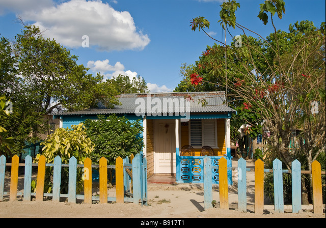 Colorful traditional wood house Bayahibe fishing village clinging to traditional lifestyle despite tourism impact - Stock Image