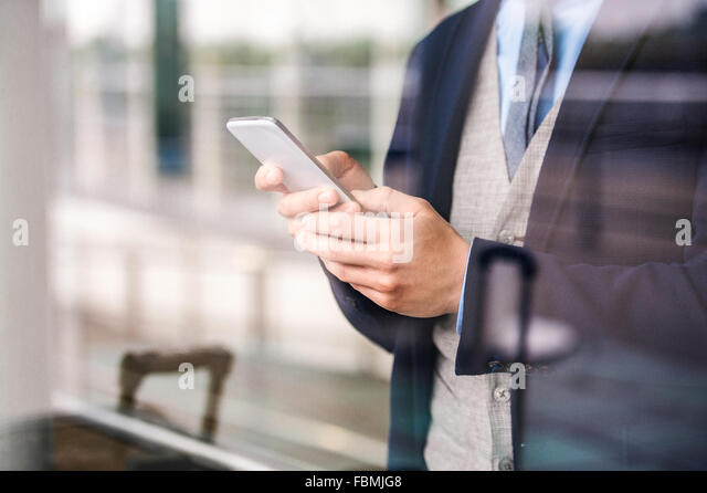 Man with smart phone - Stock Image