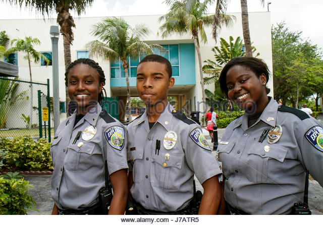 North Miami Beach Florida Police Station police explorer Black boy girl teen student intern career preparation - Stock Image