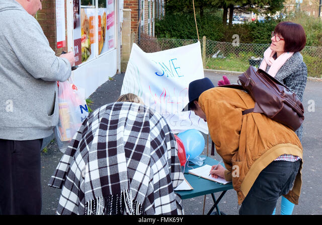 Bevendean, Brighton, UK - 12h March, 2016: Local people at a local shopping parade with banners collect signatures - Stock Image