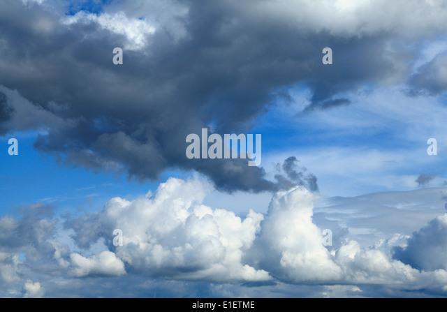 White cumulus clouds, grey clouds, blue sky cloud skies UK - Stock Image