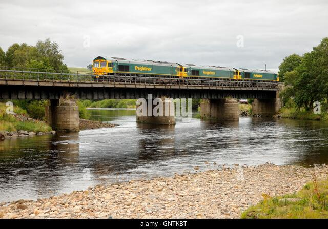 Class 66 Freightliner freight trains. South Tyne, Ridley Hall Railway Bridge, Bardon Mill, Newcastle & Carlisle - Stock Image
