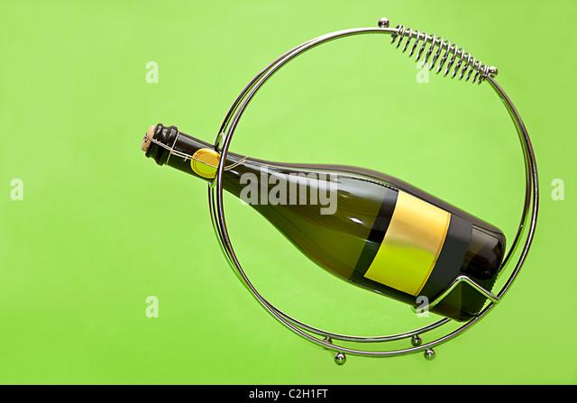bottle of wine on the green background - Stock-Bilder