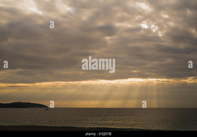 Crepuscular rays as seen from Falmouths Gyllyngvase Beach 8th October 2016 - Stock Image