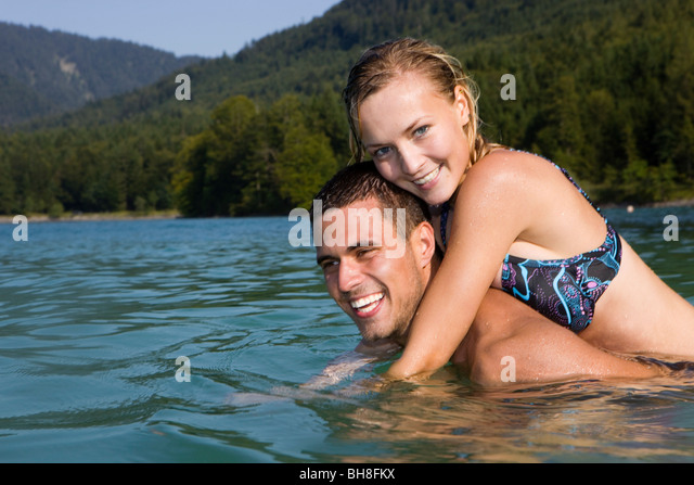 A couple having fun in the water - Stock Image