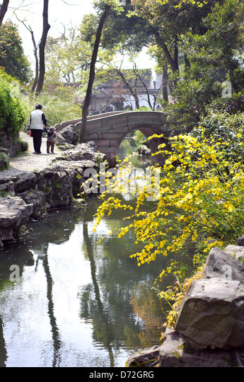 Bridge and stream in the Garden of the Humble Administrator, Suzhou - Stock Image