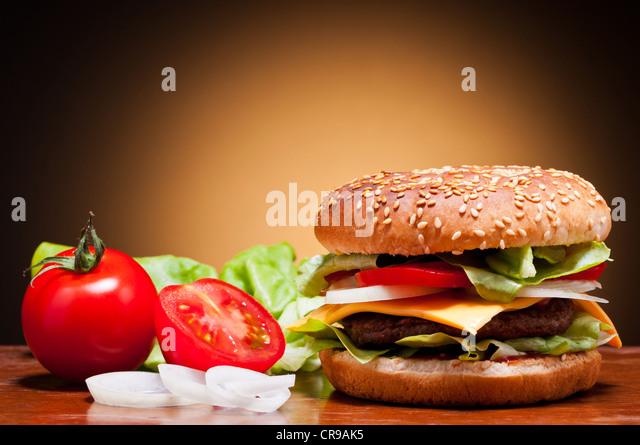 traditional hamburger and vegetables still life - Stock Image
