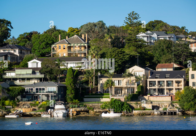 Sydney Australia NSW New South Wales Harbour harbor water waterfront homes houses Hunters Hill Parramatta River - Stock Image