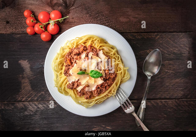 Pasta bolognese on rustic background with copyspace - Stock Image