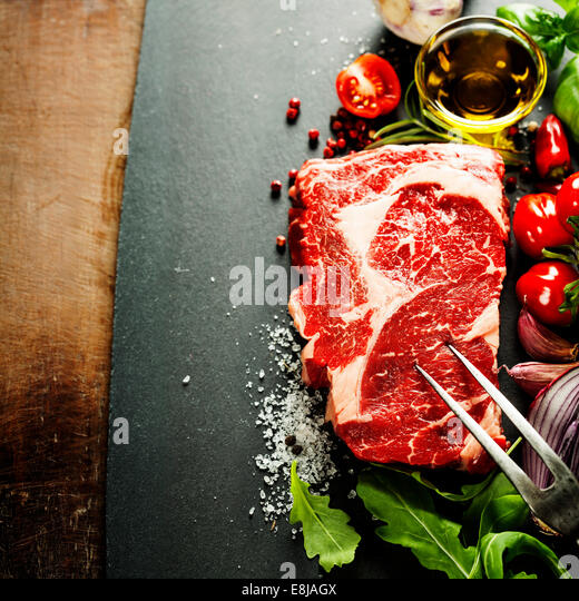 Marbled beef steak with meat fork and vegetables  in a grill pan - Stock Image