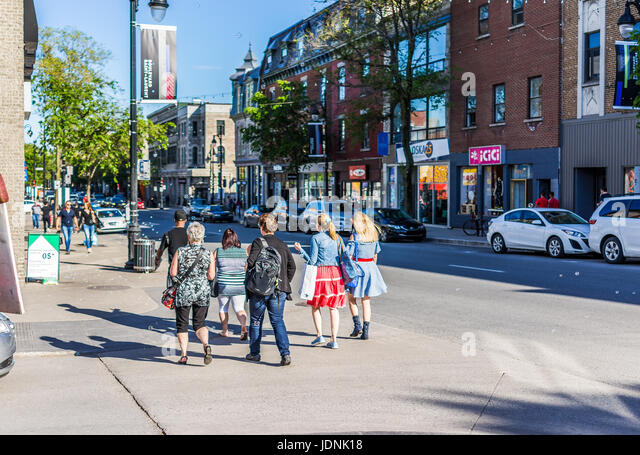 Montreal, Canada - May 27, 2017: People walking on Saint Laurent boulevard in Montreal's Plateau Mont Royal - Stock Image