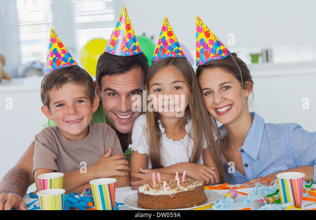 Beautiful family celebrating a party - Stock Image