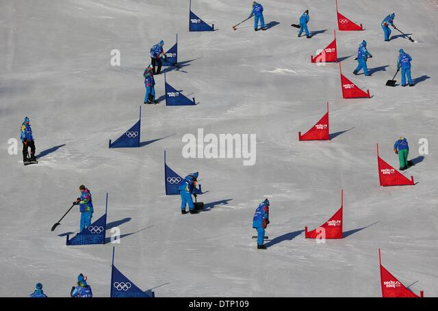 Sochi, Russia. 22nd February 2014. Workers prepare the track prior to the Snowboard Parallel Slalom (PSL) of the - Stock Image