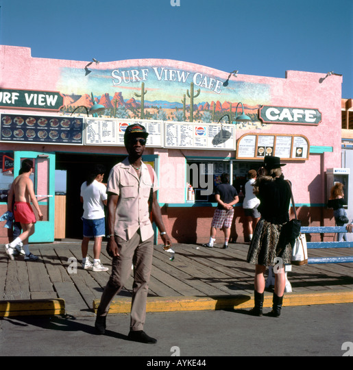 Archival photo of people on the boardwalk outside the Surf View Cafe Santa Monica Pier in Los Angeles, California - Stock Image