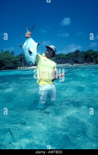 Belize salt water Fishing Man Holding Permit - Stock Image