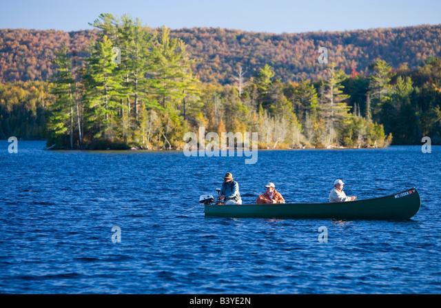 Motorized canoe stock photos motorized canoe stock for Fishing lakes around me