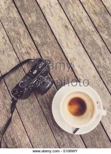 Empty Coffee Cup & Fuji x100T Camera - Stock Image
