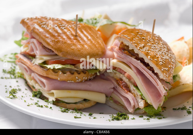 Ham,cheese and vegetable sandwich - Stock Image