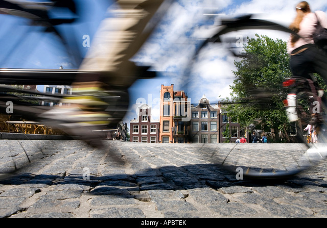 Bike in motion, Amsterdam, the Netherlands - Stock Image