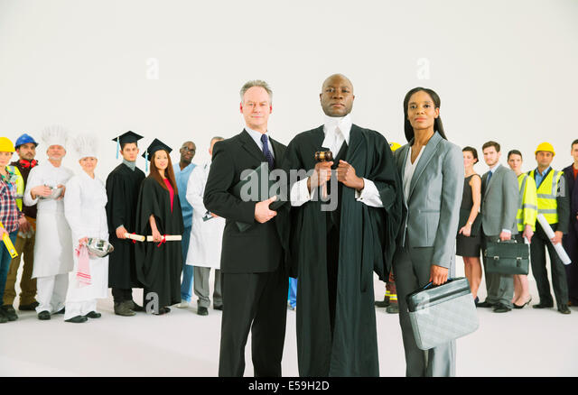 Workforce behind confident lawyers and judge - Stock Image