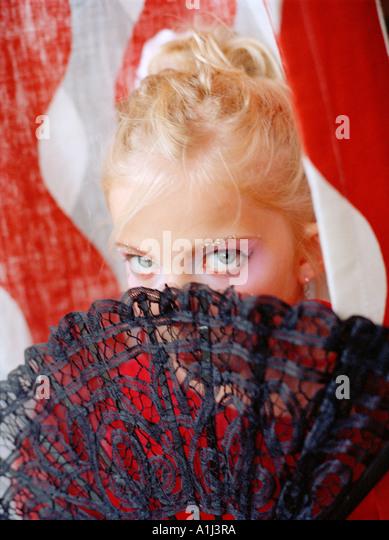 Flamenco-girl hiding behind a fan - Stock-Bilder