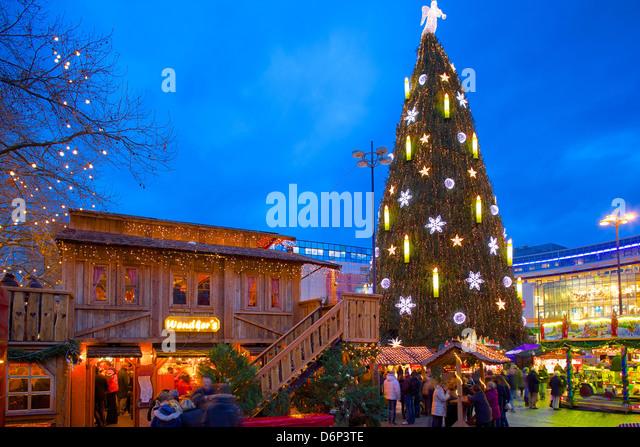 Christmas Market and the Biggest Christmas Tree in the World, Hansaplatz, Dortmund, North Rhine-Westphalia, Germany, - Stock Image