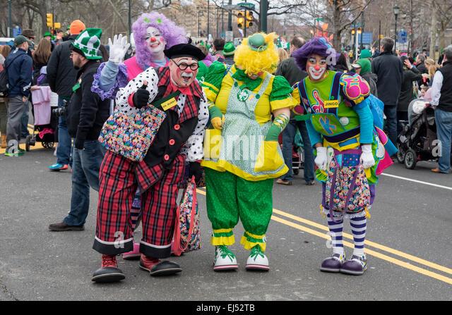 Four funny clowns cheer the parade,  St. Patrick's Day Parade, Philadelphia, USA - Stock Image