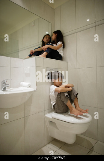 Girl toilet sitting stock photos girl toilet sitting for Girls in bathroom with boys