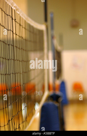 Volleyball net in gymnasium. - Stock Image