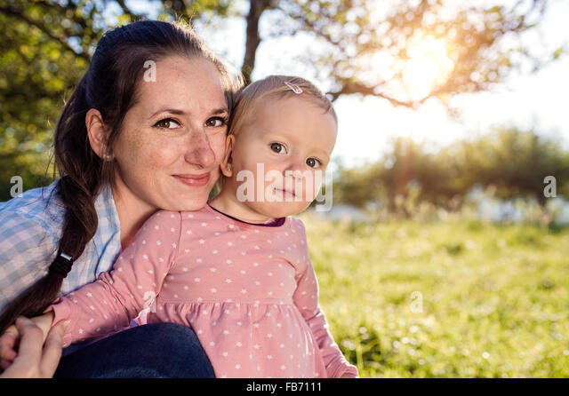 Happy mother and her daughter - Stock Image