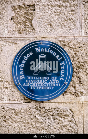 Barbados National Trust marker designating a building of historic and architectural interest. - Stock Image