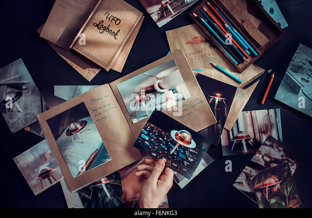 UFO hunter logbook - Stock Image